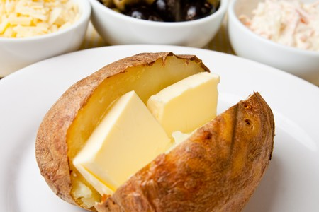 oven potatoes: Hot and crispy baked potato stuffed with melting butter