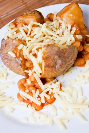 oven potatoes: Hot and crispy baked potato stuffed with baked beans and grated cheese