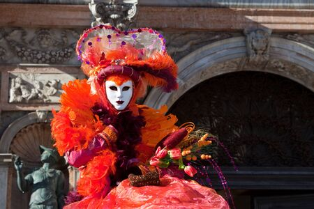conceal: Orange costume at the Venice Carnival