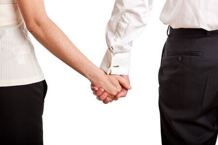 Man and a woman holding hands Imagens