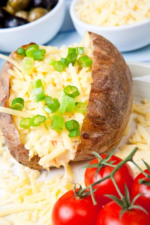 spud: Hot and crispy baked potato stuffed with cheddar cheese and coleslaw