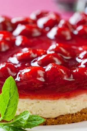 Delicious strawberry cheese cake with fresh mint on a white plate photo