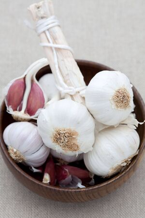 Fresh garlic in a wooden bowl