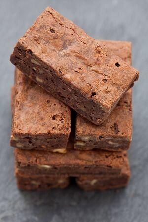 Pile of freshly baked chocolate brownies Imagens