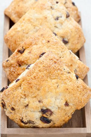 Four home baked scones in a wooden tray Stock Photo - 6575984