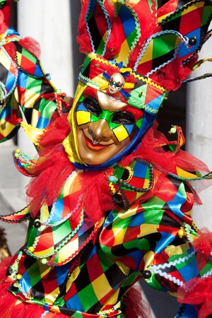 mardi gras mask: Portrait of a Joker in costume at the Venice Carnival, Italy.