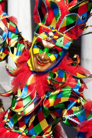 joker: Retrato de un Joker en traje en el Carnaval de Venecia, Italia.  Foto de archivo