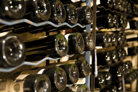 red wine bottles in a cellar
