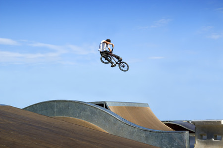 freestyle: High BMX jump in a skate park