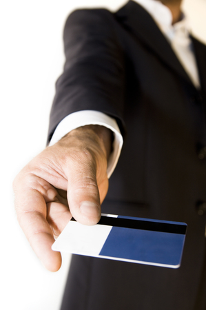 Close-up of a credit card in businessmans hand