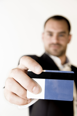 Man showing a magnetic card