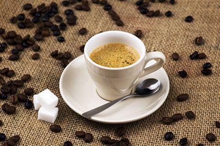 Cup of coffee on coffee sack Stock Photo