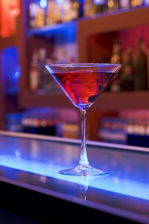 cocktail drink on a bar, blurry background Stock Photo