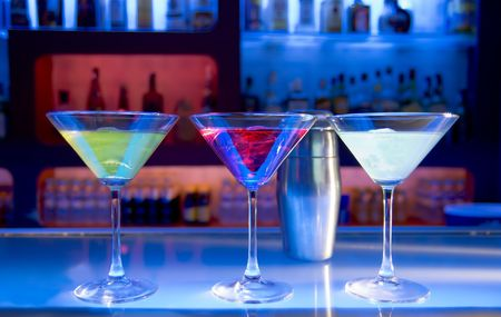 cocktail drinks and shaker on a bar, blurry bar background Stock Photo