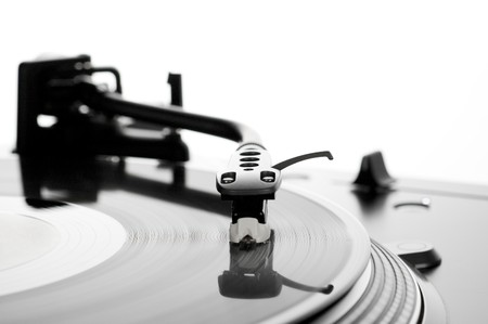 Turntable with spinning record, focus on stylus