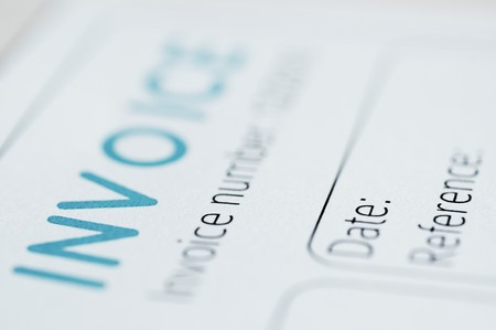 invoice: Close-up picture of an invoice, light blue tint. Stock Photo