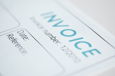 Close-up picture of an invoice, light blue tint. Stock Photo