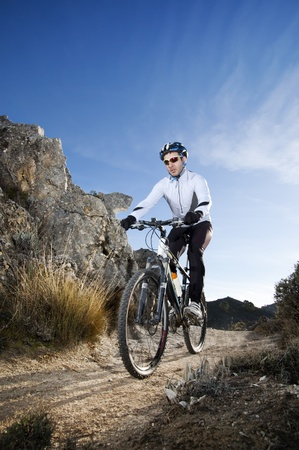 mountainbike: Man riding a mountainbike on a mountain track