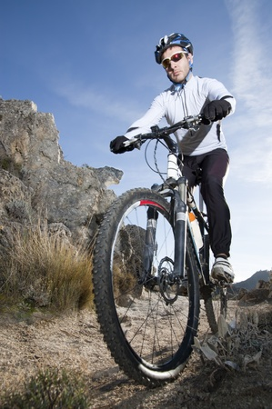 Man riding a mountainbike on a mountain track Stock Photo - 8294919