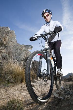 Man riding a mountainbike on a mountain track Stock Photo - 8294919