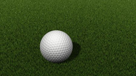 white golf ball on green grass photo