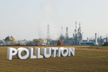 smoke stack: refinery and ecology concept with word pollution