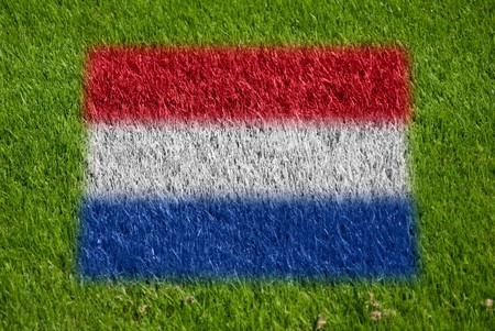 fairplay: flag of netherlands on grass with spray Stock Photo