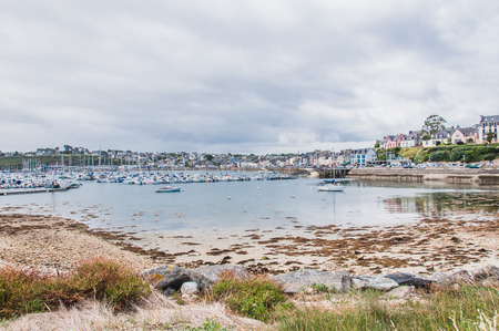 Port of Camaret-sur-mer with its boats, its lighthouse, in Finistère in Brittany, France Stock Photo