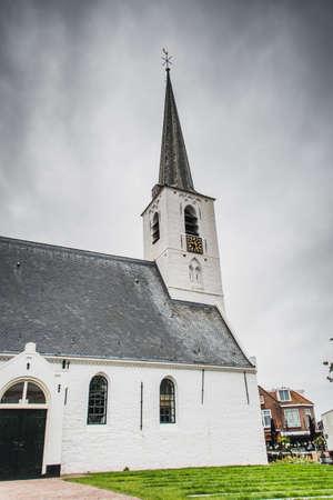 White church in Noordwijkerhout in the Netherlands with cloudy sky 版權商用圖片