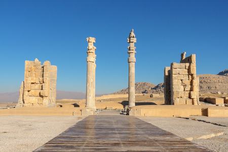 Gate of All Nations-Persepolis. A pair of Lamassus, bulls with the head of a bearded man, stands by the western threshold. Another pair, with wings and a Persian head, stands by the eastern entrance.Built by Xerxes. The gate was a square hypostyle hall with 3 doors and 4 columns.A pair of Lamassus, bulls with the head of a bearded man, stands by the western threshold. Another pair, with wings and a Persian head (Gopät-Shäh), stands by the eastern entrance, to reflect the Empire's power.Xerxes name was written in three languages and carved on the entrances, informing everyone that he ordered it to be built. Stock Photo