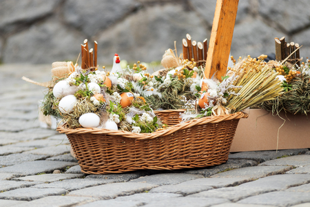 Traditional Easter decorative symbols made from natural materials, rabbit, chickens, hen, straw, eggs, easter street market.