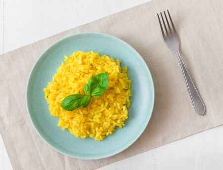 Risotto Milanese, the dish with traditional Italian saffron risotto. Top down view.