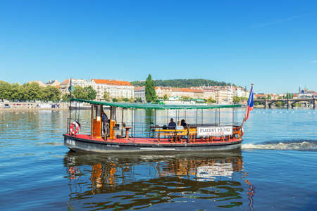 """PRAGUE - August 1st: Ferry """"Semik"""" does his sail on August 1st, 2020 in Prague. Semik connects riverbanks Naplavka Podskali with Naplavka Smichov."""