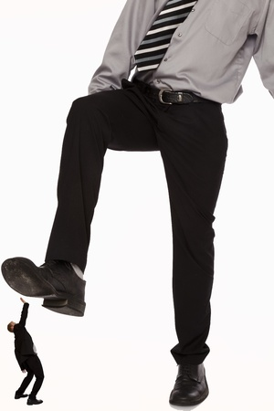 Businessman getting crushed by another businessman   Stock Photo - 12565962