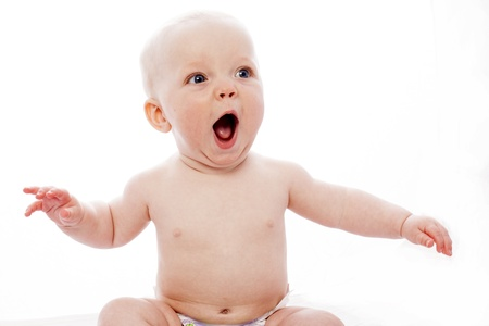 babies laughing: surprised baby with white background