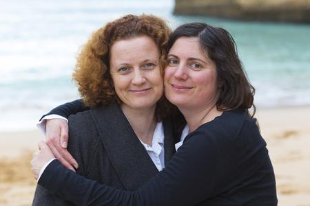 two women hugging: two friends hugging