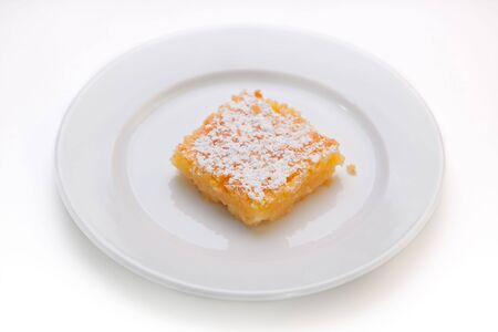 Lemon square on plate Stock Photo