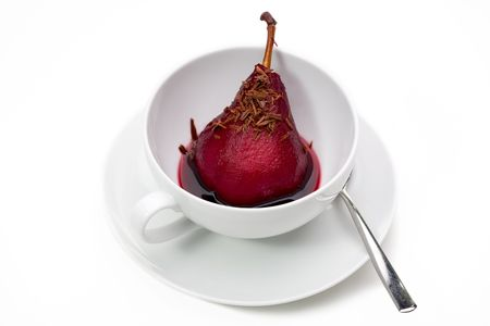 poach: Pear with stem poached in red wine in cup with chocolate shavings.