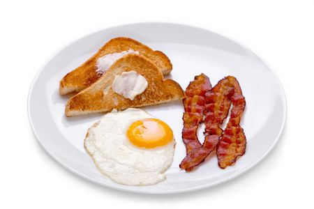 Bacon, eggs and toast breakfast on white plate on white background.
