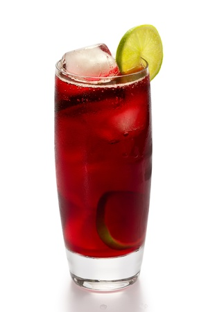 A glass of iced hibiscus tea with slices of lime on white background.