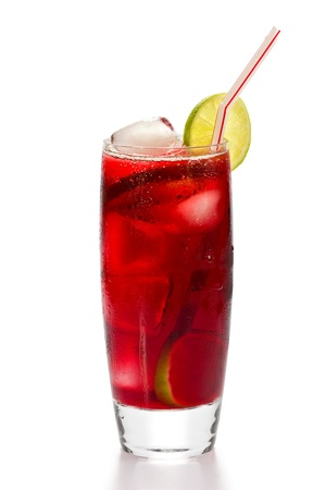 A glass of iced hibiscus tea with slices of lime, and drinking straw, on white background. Banco de Imagens