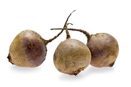 Three raw beets on white background.