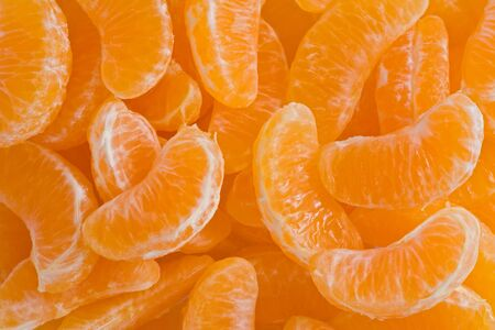 Background texture of slices of clementine oranges. Imagens