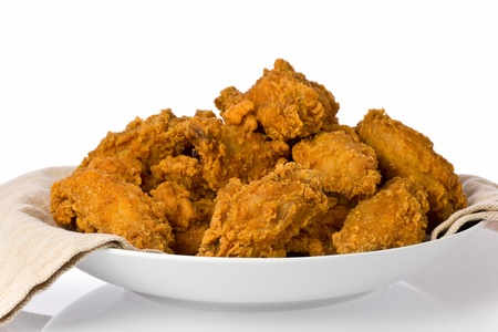 Plate of crispy fried chicken wings and drumsticks. Stock Photo