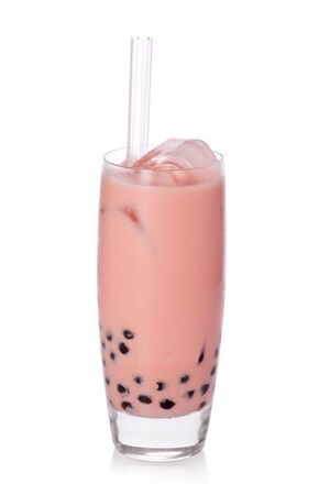 A glass of sweet strawberry milk tea with tapioca pearls, and straw on white background.