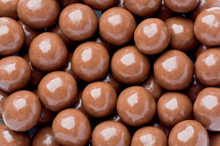 malted: Background texture of chocolate malted milk balls. Stock Photo