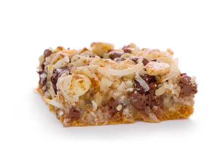 graham: Seven layer bar made with a graham cracker crust topped with chocolate chips, coconut, and chopped nuts. Stock Photo