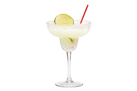 Margarita drink with sliced lime and straw against a white background.