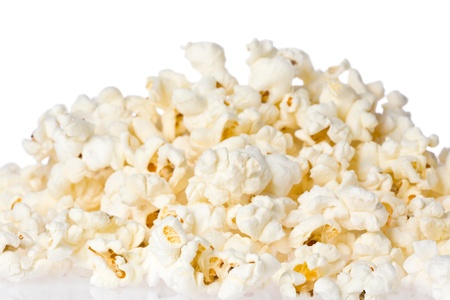 popped: Close up of a pile of freshly popped popcorn. Stock Photo