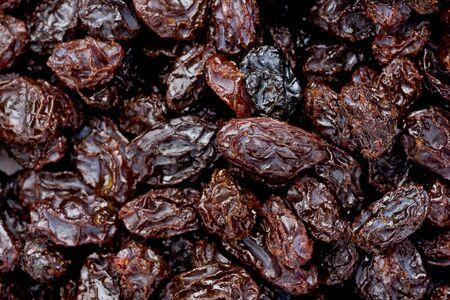 Background texture of several raisins.